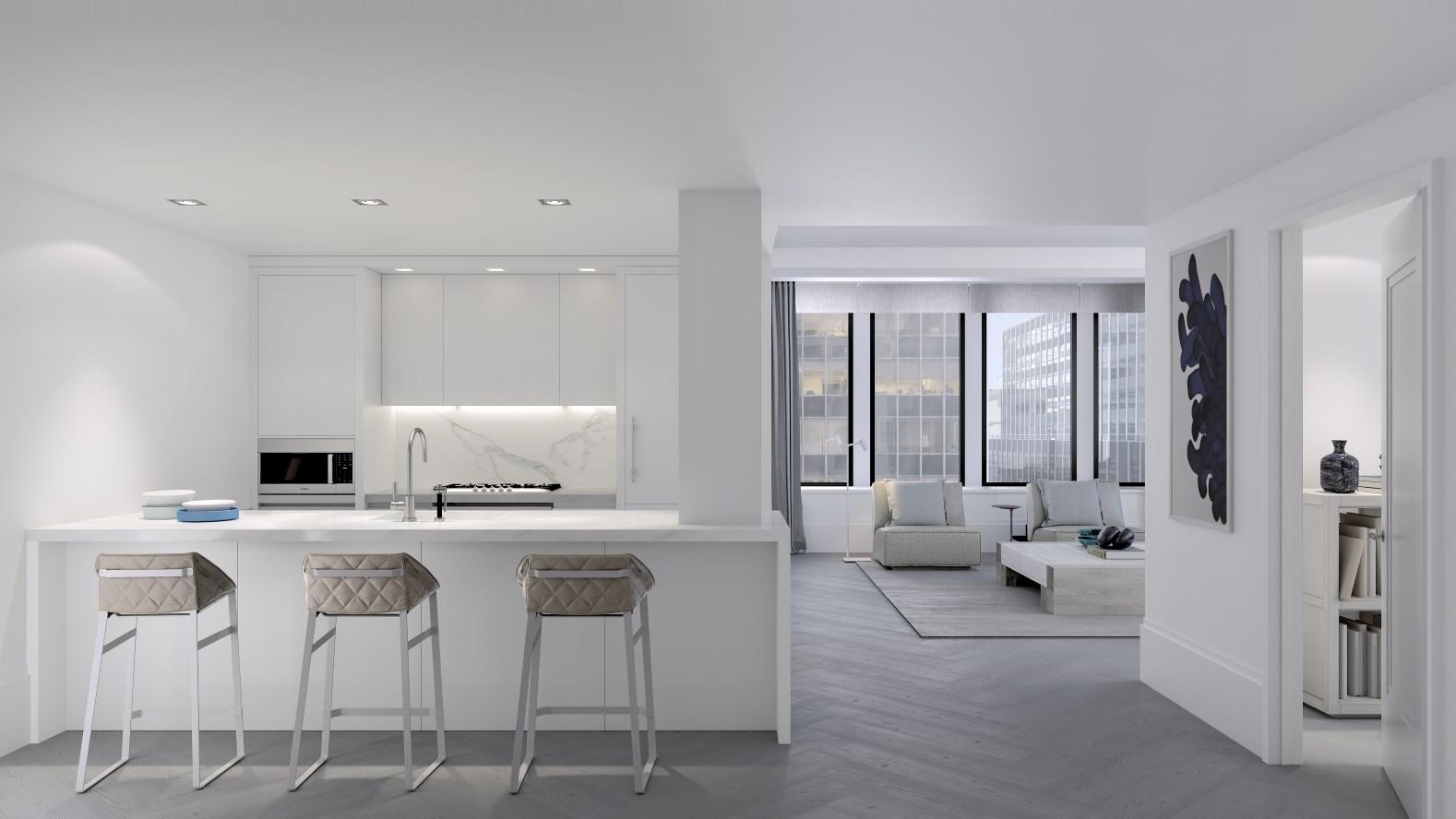 Oversized casement windows enhance light and herringbone oak floors