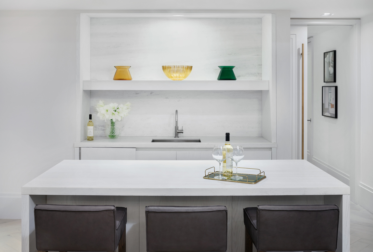 A marble-clad bar an island serviced by a discreet catering kitchen is ideal for entertaining.